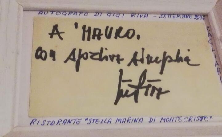 ho incontrato riva nel 2007 al ristorante questo il suo autografo che conservo gelosamente in cornice (mauro frau da domusnovas residente a roma)