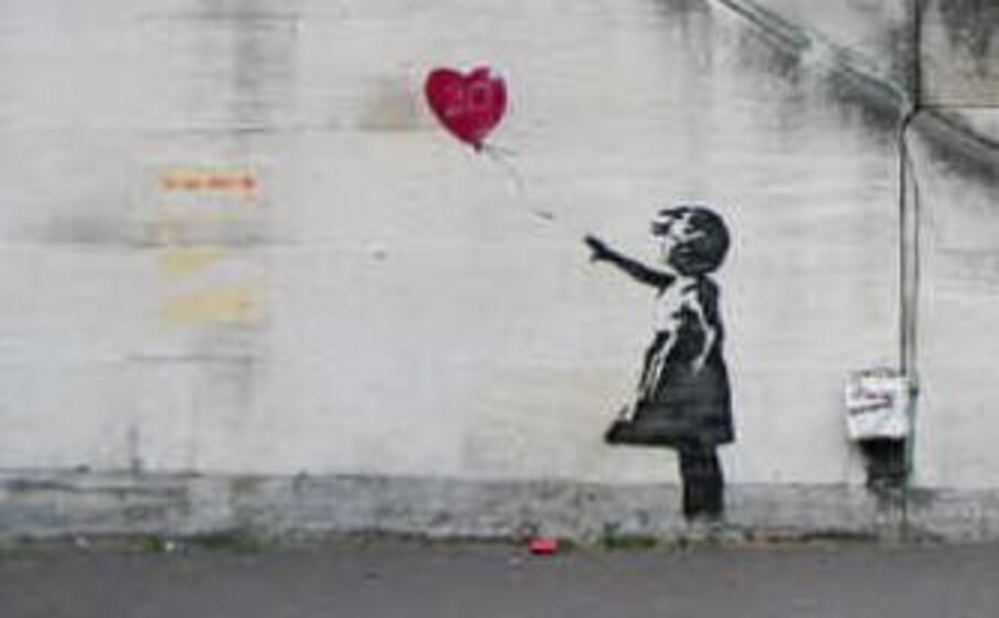 la celebre realizzazione di banksy (foto da google)