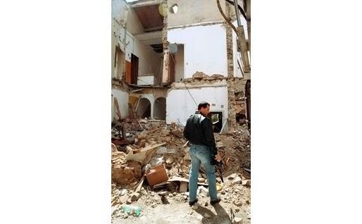 La palazzina di via Landi distrutta dall'esplosione foto Ansa